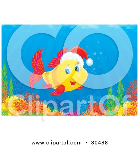 Royalty-Free (RF) Clipart Illustration of a Yellow Marine Fish Swimming Over A Reef And Wearing A Santa Hat by Alex Bannykh