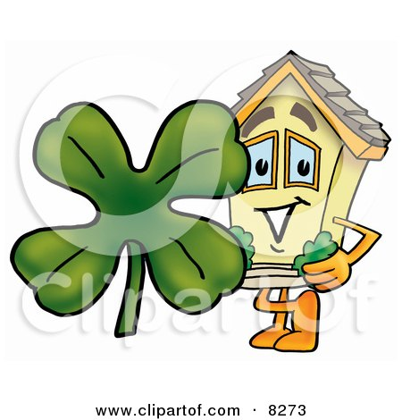 Clipart Picture of a House Mascot Cartoon Character With a Green Four Leaf Clover on St Paddy's or St Patricks Day by Toons4Biz