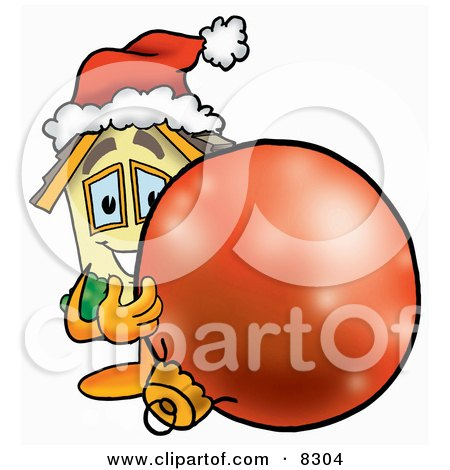Clipart Picture of a House Mascot Cartoon Character Wearing a Santa Hat, Standing With a Christmas Bauble by Toons4Biz