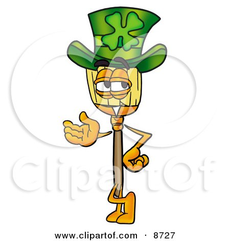 Clipart Picture of a Broom Mascot Cartoon Character Wearing a Saint Patricks Day Hat With a Clover on it by Toons4Biz