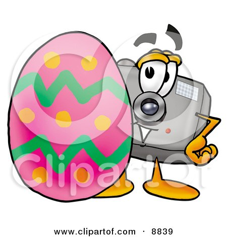 Clipart Picture of a Camera Mascot Cartoon Character Standing Beside an Easter Egg by Toons4Biz