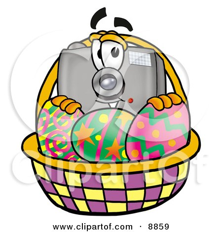 Clipart Picture of a Camera Mascot Cartoon Character in an Easter Basket Full of Decorated Easter Eggs by Toons4Biz