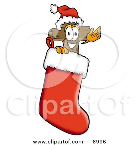 Clipart Picture of a Wooden Cross Mascot Cartoon Character Wearing a Santa Hat Inside a Red Christmas Stocking by Toons4Biz