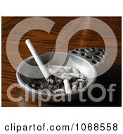 Smoking Cigarette Burning In A Pewter Ashtray Royalty Free Stock Photo