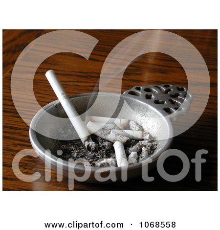 Smoking Cigarette Burning In A Pewter Ashtray - Royalty Free Stock Photo by Kenny G Adams