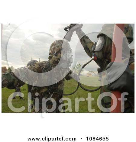 Soldier Being Decontaminated - Free Stock Photography by JVPD