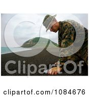 Soldier Collecting Sand From Iwo Jima Free Stock Photography by JVPD