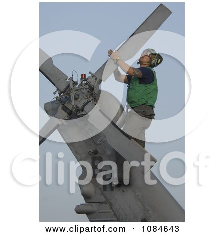 Soldier During Corrosion Maintenance on a Military Helicopter - Free Stock Photography by JVPD