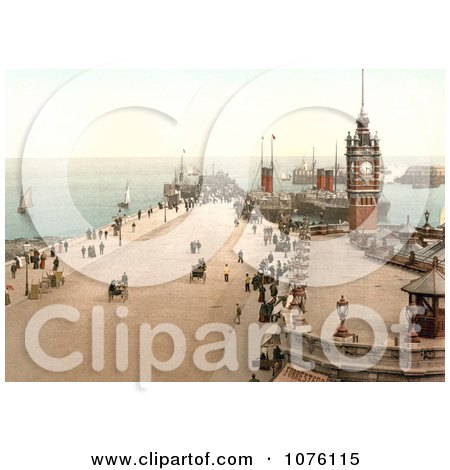 Steamers and Sailboats in the Harbor and People Near the Clock Tower on Victoria Pier Douglas Isle of Man England - Royalty Free Stock Photography  by JVPD