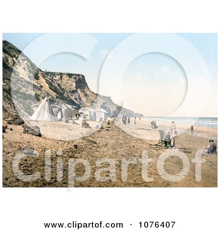 Tents and People on the Beach in Overstrand Norfolk England - Royalty Free Stock Photography  by JVPD