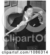 The New York Yankees Baseball Player Joe Dimaggio Sitting In A Chair And Kissing His Signature Baseball Bat 1941 Free Historical Baseball Stock Photography by JVPD