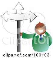 Businessman Holding A Crossroads Sign