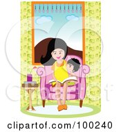 Mother And Son Reading A Book In A Chair