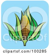Royalty Free RF Clipart Illustration Of An Ear Of Corn With Green Foliage Over Blue by Lal Perera