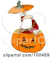 Santa Popping Out Of A Halloween Pumpkin And Holding The Top Over His Head