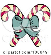 Green Bow Tying Together Two Christmas Candy Canes
