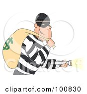Grinning Male Robber In A Striped Shirt Shining A Flashlight And Carrying A Money Bag