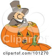 Thanksgiving Pilgrim Standing In A Giant Pumpkin