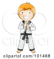 Happy Red Haired Boy Standing In A Karate Suit