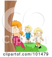 Boy And Two Girls Playing Hide And Seek Outdoors by BNP Design Studio
