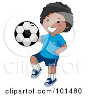 Happy Black Boy Kicking A Soccer Ball With His Knee