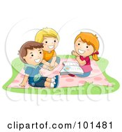 Girl And Two Boys Sitting On A Blanket And Telling Stories
