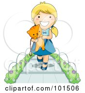 Happy Blond Girl Walking On A Sidewalk And Carrying A Kitten