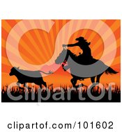 Silhouetted Cowboy On Horseback Roping Cattle Against An Orange Sunset