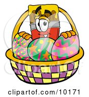 Clipart Picture Of A Paint Brush Mascot Cartoon Character In An Easter Basket Full Of Decorated Easter Eggs by Toons4Biz