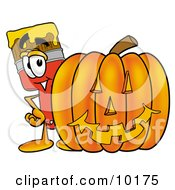 Clipart Picture Of A Paint Brush Mascot Cartoon Character With A Carved Halloween Pumpkin by Toons4Biz