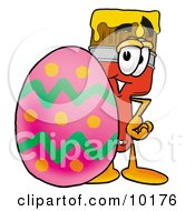 Clipart Picture Of A Paint Brush Mascot Cartoon Character Standing Beside An Easter Egg by Toons4Biz