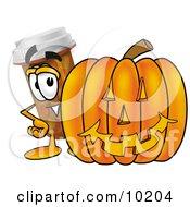 Pill Bottle Mascot Cartoon Character With A Carved Halloween Pumpkin