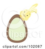 Royalty Free RF Clipart Illustration Of A Yellow Rabbit Behind A Brown And Green Easter Egg by Cherie Reve