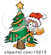 Pencil Mascot Cartoon Character Waving And Standing By A Decorated Christmas Tree by Toons4Biz