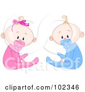 Boy And Girl Baby Twins With Pacifiers