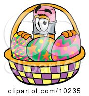 Pencil Mascot Cartoon Character In An Easter Basket Full Of Decorated Easter Eggs