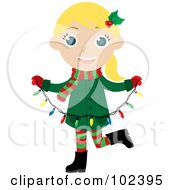 Blond Caucasian Christmas Girl Holding A Strand Of Christmas Lights
