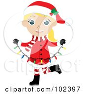 Blond Girl In A Christmas Suit Carrying Christmas Lights