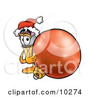 Pencil Mascot Cartoon Character Wearing A Santa Hat Standing With A Christmas Bauble