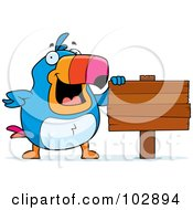 Royalty Free RF Clipart Illustration Of A Happy Toucan Presenting A Wood Sign by Cory Thoman