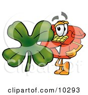 Clipart Picture Of A Red Telephone Mascot Cartoon Character With A Green Four Leaf Clover On St Paddys Or St Patricks Day