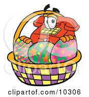 Clipart Picture Of A Red Telephone Mascot Cartoon Character In An Easter Basket Full Of Decorated Easter Eggs