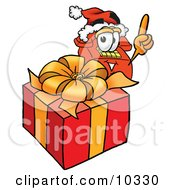 Clipart Picture Of A Red Telephone Mascot Cartoon Character Standing By A Christmas Present