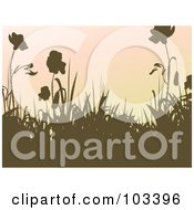 Brown Silhouetted Grass And Flowers Against A Gradient Pink Sky