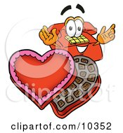Clipart Picture Of A Red Telephone Mascot Cartoon Character With An Open Box Of Valentines Day Chocolate Candies