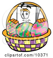Clipart Picture Of A Paper Mascot Cartoon Character In An Easter Basket Full Of Decorated Easter Eggs by Toons4Biz