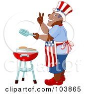 Patriotic African American Man Cooking On A Barbecue