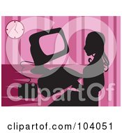 Silhouetted Woman Using A Computer Over Pink