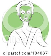 Woman In A Robe And Green Facial Mask