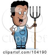 Happy Black Farmer Boy With A Pitchfork